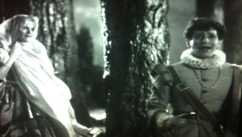 Jean Muir as Helena and Ross Alexander as Demetrius.